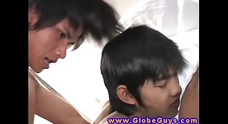 Young asian twinks tug their dicks after anal